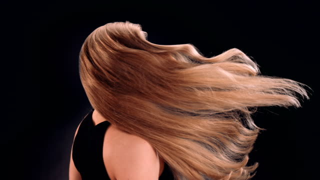 strong and beautiful blond woman tossing her long, wavy hair - blonde hair stock videos & royalty-free footage