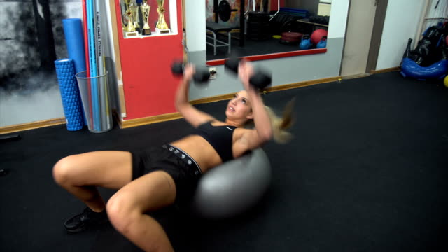 strong and beautiful - fitness ball stock videos & royalty-free footage