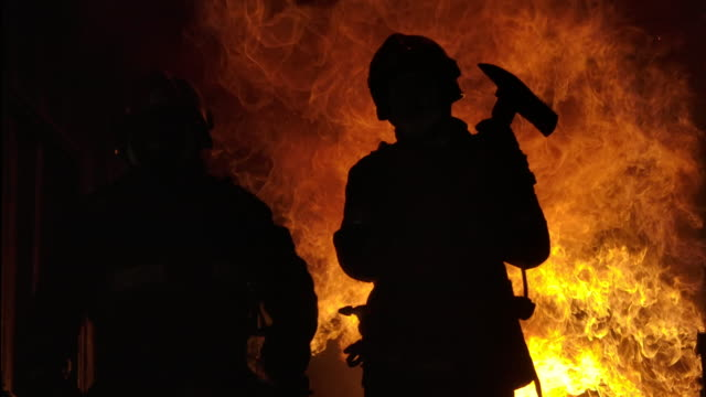 strong and brave firefighter. - firefighter stock videos & royalty-free footage