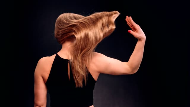 strong, athletic woman tossing her long, wavy hair - hair treatment stock videos and b-roll footage