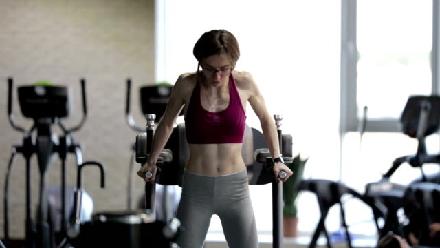 strong beauty young girl female bodybuilder doing exercise in gym - human limb stock videos & royalty-free footage