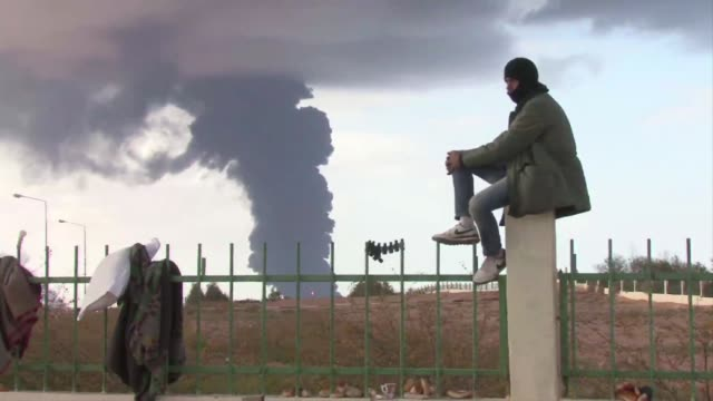 vídeos de stock, filmes e b-roll de strong blasts rocked libya's rebel-held eastern oil town of ras lanuf, where insurgents were forced back from the front lines on wednesday. ras... - 1 minuto ou mais