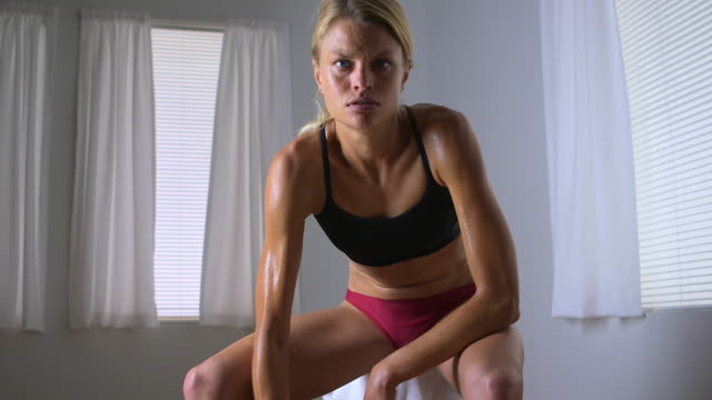 strong blonde woman lifting weights - only mid adult women stock videos & royalty-free footage