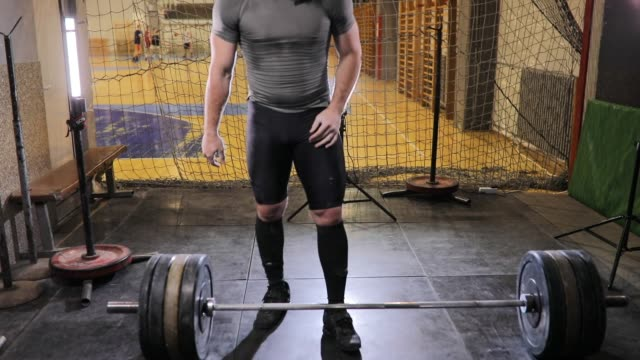 strong body builder weightlifting in gym - crouching stock videos & royalty-free footage