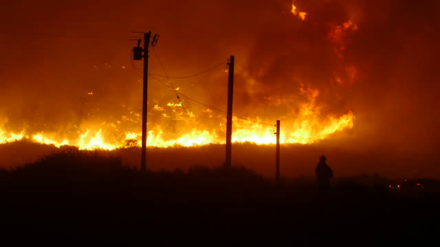 strong dry winds made it easy for the fire to spread rapidly and difficult for responders to contain / hillside on fire near 101 freeway with cars... - ventura stock videos and b-roll footage