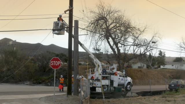 strong dry winds made it easy for the fire to spread rapidly and difficult for responders to contain / utility workers repair damaged power and... - ventura stock videos and b-roll footage