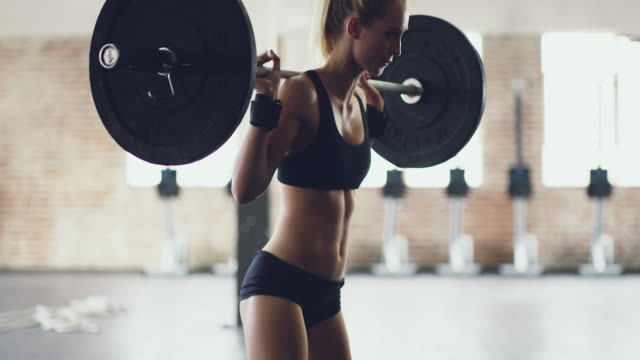 strong is what she's aiming for - gym stock videos & royalty-free footage
