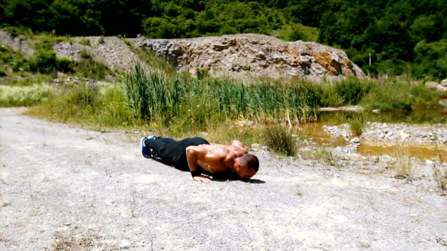 strong man do push ups in the air - tracksuit bottoms stock videos & royalty-free footage