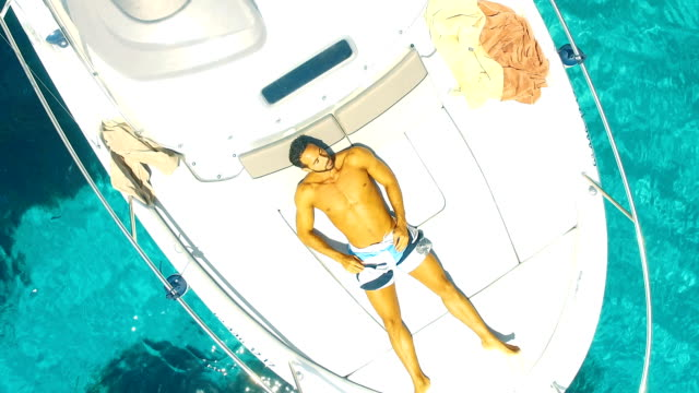 strong man relaxed in yatch - silvestre stock-videos und b-roll-filmmaterial