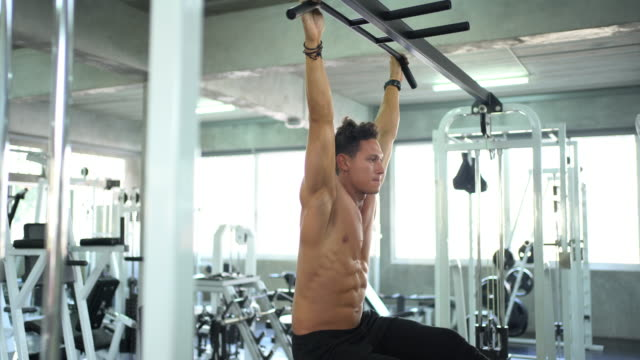 strong men are exercising using a horizontal bar - horizontal bar stock videos and b-roll footage
