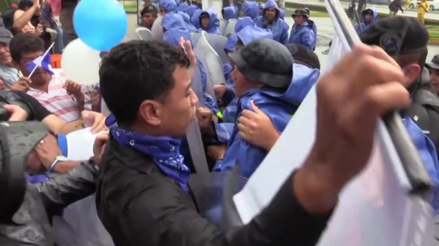 strong police deployment stops opposition protesters in the nicaraguan capital of managua from marching to commemorate the death of student matt... - managua stock videos & royalty-free footage