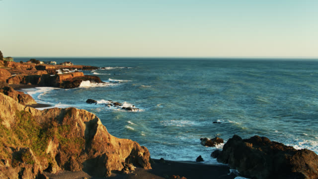 strong waves hitting cliffs and beach at shelter cove, california - aerial - black sand stock videos & royalty-free footage