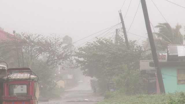 strong wind and rain lash street in aparri, philippines as typhoon megi or juan hits. super typhoon megi or juan, ne luzon, philippines oct 2010 / audio - luzon stock videos & royalty-free footage