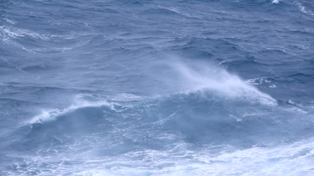 strong wind blowing the tops of waves in the southern ocean - antarctic ocean stock videos and b-roll footage