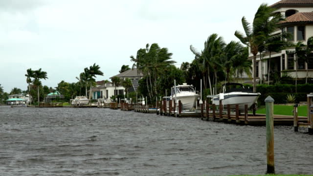 strong wind blows over marina the day before hurricane irma hits naples, florida - naples florida stock videos & royalty-free footage