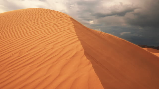 strong wind in the desert. sand blows from the dunes. sahara desert - doha stock videos & royalty-free footage