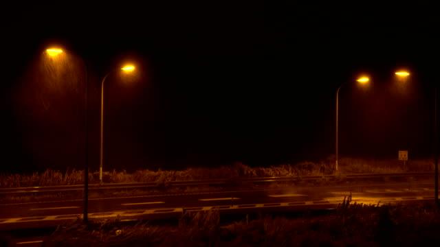 strong winds and heavy rain from typhoon jongdari hit highway at night in japan - ナイトイン点の映像素材/bロール