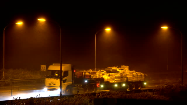 Strong winds and heavy rain from typhoon Jongdari hit highway traffic at night in Japan