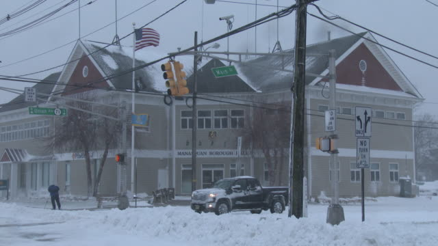 Strong winds and heavy snow batter Main Street in Freehold NJ during the historic Blizzard Of 2016
