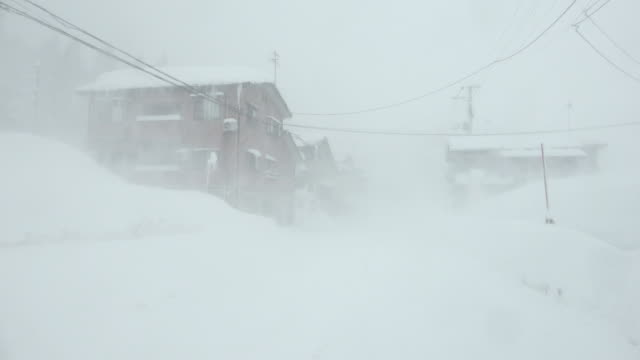 Strong winds and heavy snow lash town during major blizzard in northern Japan