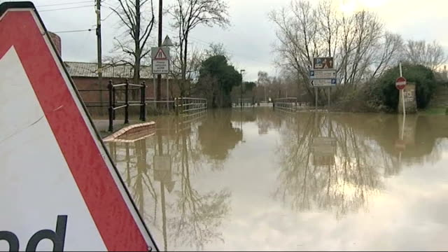 strong winds and more rain predicted to hit uk england gloucestershire tewkesbury ext 'flood' road warning sign pan flooded road as church bells... - gloucestershire stock videos and b-roll footage