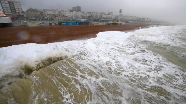 strong winds and waves hit the coast of brighton - brighton england stock videos & royalty-free footage