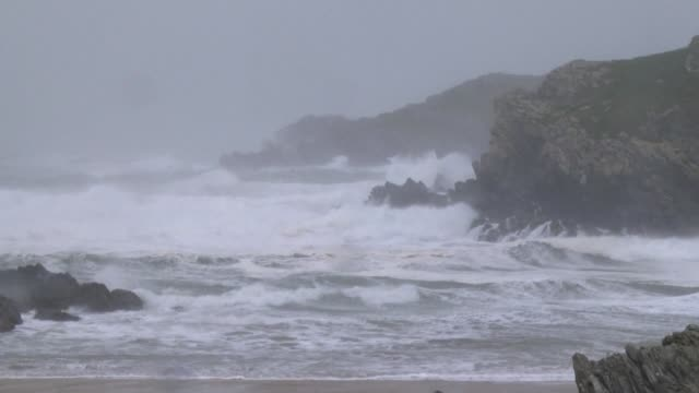 Strong winds batter Wales in the United Kingdom as nearby Ireland is hit by an unprecedented storm that left three people dead more than 300000...