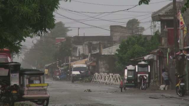 strong winds blow through streets of aparri as typhoon megi or juan approaches. super typhoon megi or juan, ne luzon, philippines oct 2010 / audio - record breaking stock videos & royalty-free footage