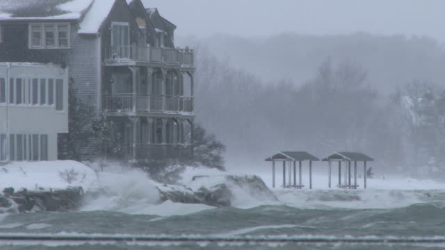 Strong winds creating high surf and storm surge on the shore during a New England blizzard