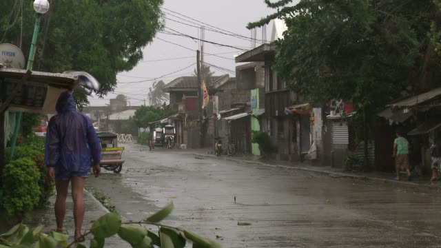 strong winds from typhoon megi tear through streets of aparri. super typhoon megi or juan, ne luzon, philippines oct 2010 / audio - emergency shelter stock videos & royalty-free footage