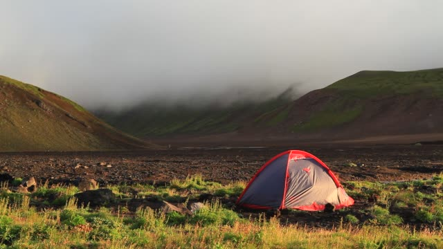 stockvideo's en b-roll-footage met strong winds in the camp. kamchatka, russia - tent