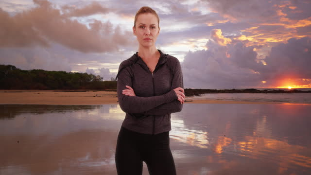 strong woman athlete standing at the beach - body building stock videos & royalty-free footage