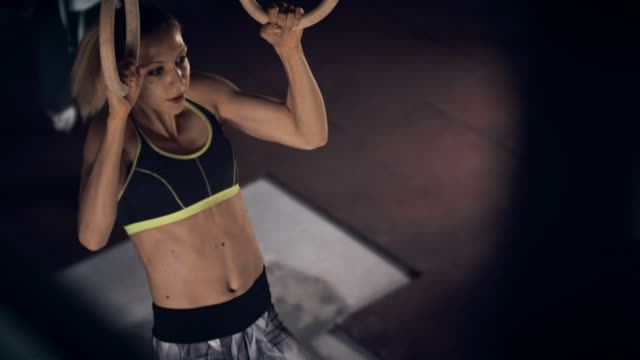 strong woman on gym rings - chin ups stock videos and b-roll footage