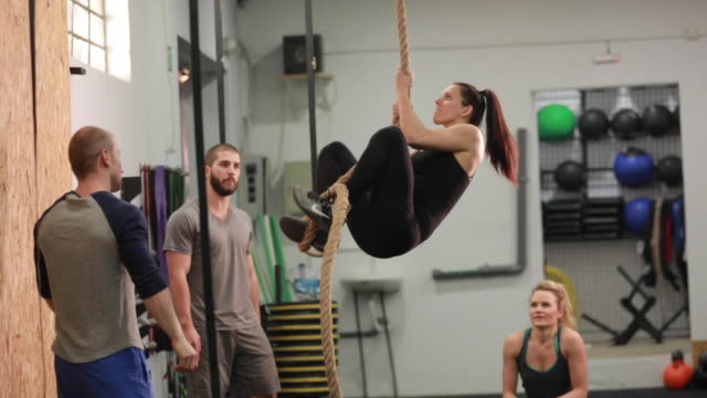 strong woman on rope at gym - clambering stock videos & royalty-free footage