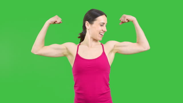 strong woman showing off bicep - bicep stock videos and b-roll footage