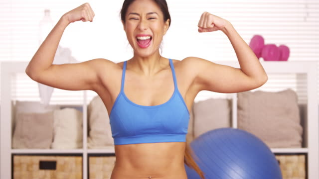 strong woman showing off muscles - flexing muscles stock videos and b-roll footage
