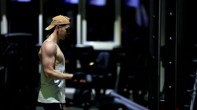 Strong young men bodybuilder doing exercise in gym