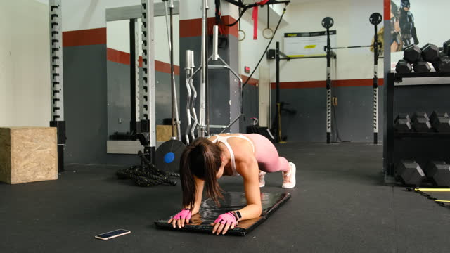 strong young sportswoman doing plank exercise in the gym - plank stock videos & royalty-free footage
