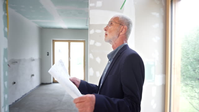 structural engineer checking the inside of a building under construction - incomplete stock videos and b-roll footage