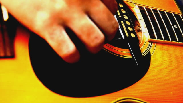 strumming guitar - musical instrument string stock videos and b-roll footage