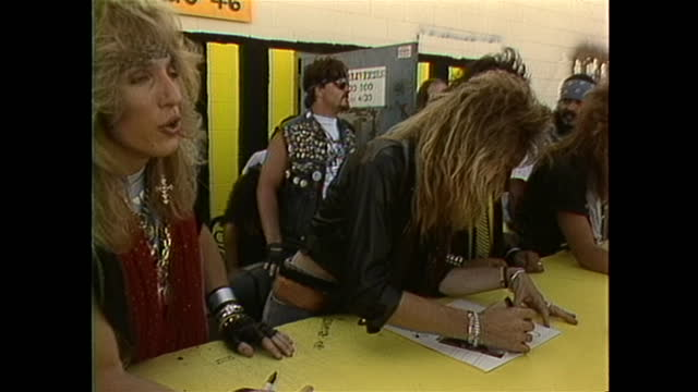 stryper an american christian metal band holds a meet and greet with their fans signing albums and other memorabilia - music or celebrities or fashion or film industry or film premiere or youth culture or novelty item or vacations stock-videos und b-roll-filmmaterial