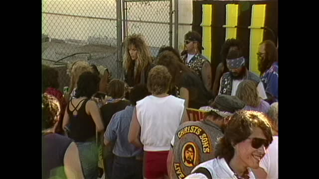 stryper, an american christian metal band holds a meet and greet with their fans, signing albums and other memorabilia. - rock group stock videos & royalty-free footage