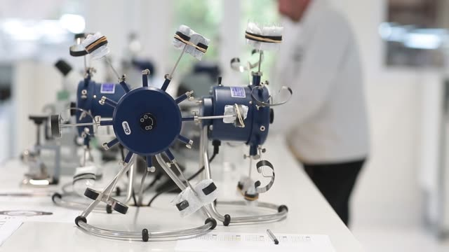 stuart duff head watchmaker at the bremont watch company builds a bremont wright flyer wristwatch at the company's headquarters in henleyonthames... - wright flyer stock-videos und b-roll-filmmaterial