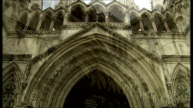 stuart hall sentence for indecent assaults doubled london the strand low angle views of the royal courts of justice - 司会者 スチュアート・ホール点の映像素材/bロール