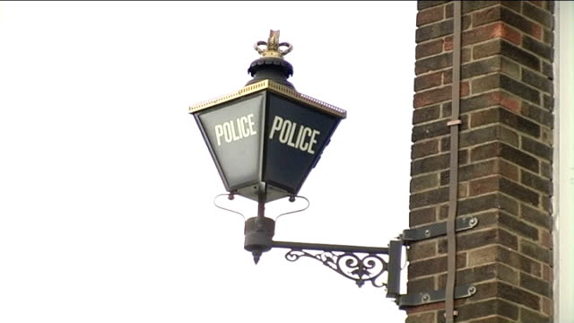 michael barrymore not charged; harlow police station: blue police lamp on side of building and 'harlow police station' sign - michael barrymore stock videos & royalty-free footage