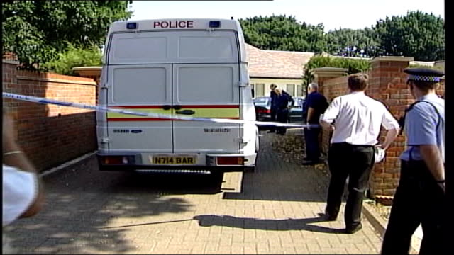 michael barrymore not charged; roydon: police van through cordon and along to barrymore's then house - michael barrymore stock-videos und b-roll-filmmaterial