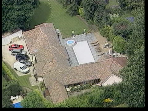 police re-examine original investigation; tx 6.6.2001 roydon: ext air view house then belonging to michael barrymore - michael barrymore stock-videos und b-roll-filmmaterial