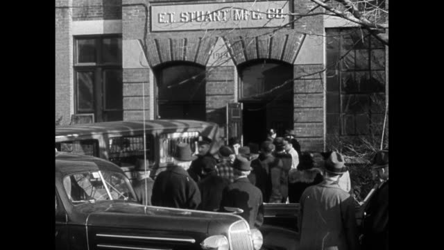 'THE STUART CASE' WS Stuart Mfg Company building w/ people police FBI gathered VS Crime Scene Watchman lying on floor inventory stock room in...