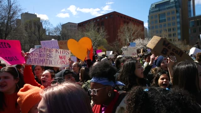 student activists rally against gun violence at washington square park near the campus of new york university april 20 2018 in new york city on the... - protesta contro la violenza armata video stock e b–roll