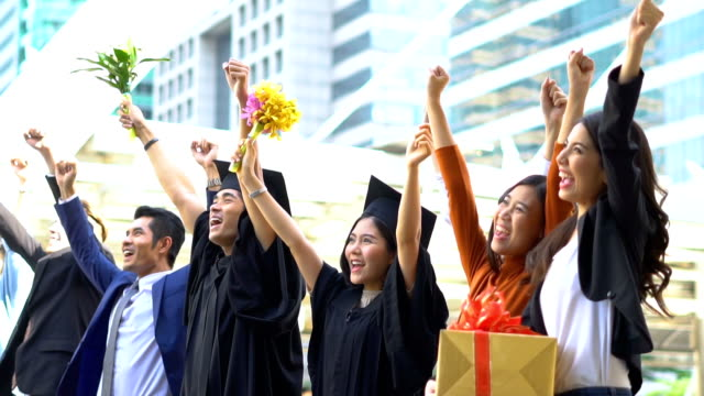 Student And Family Celebrating Graduation
